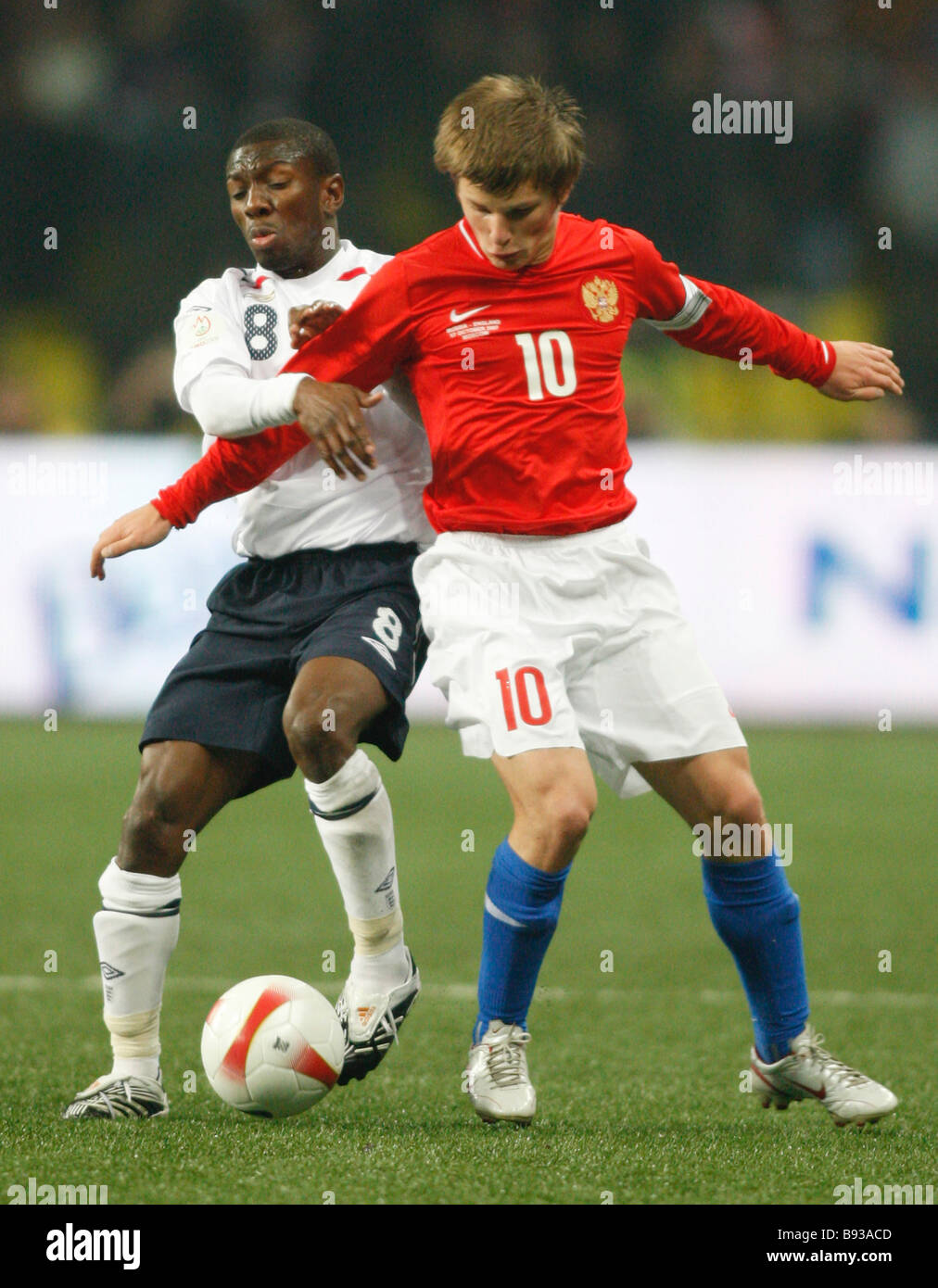 Shaun Wright Phillips of England and Andrey Arshavin of Russia from left to right during the England Russia football - Stock Image