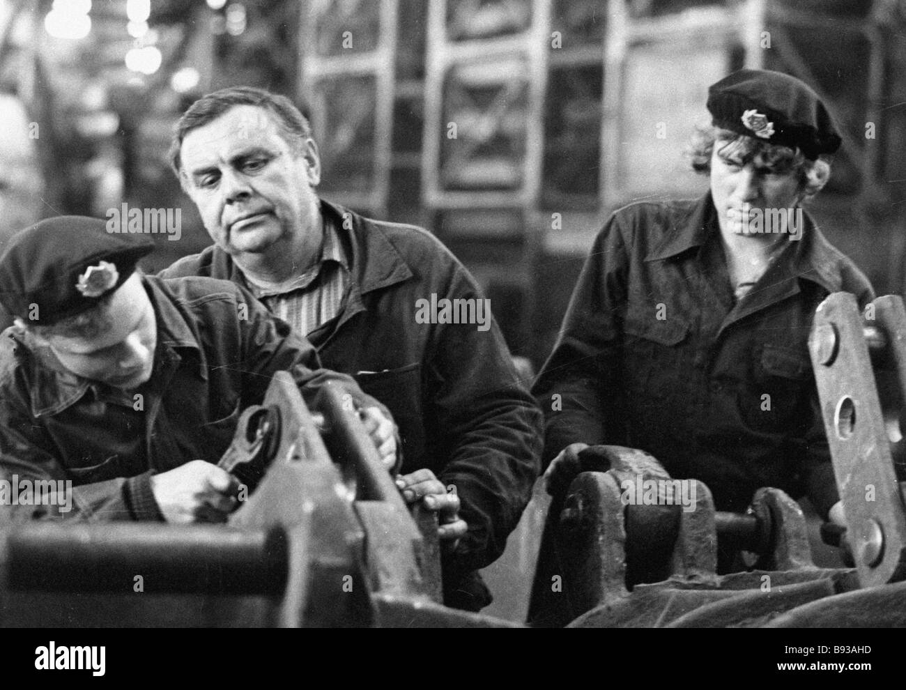 Foreman of production technical school No 57 watches over his apprentices - Stock Image