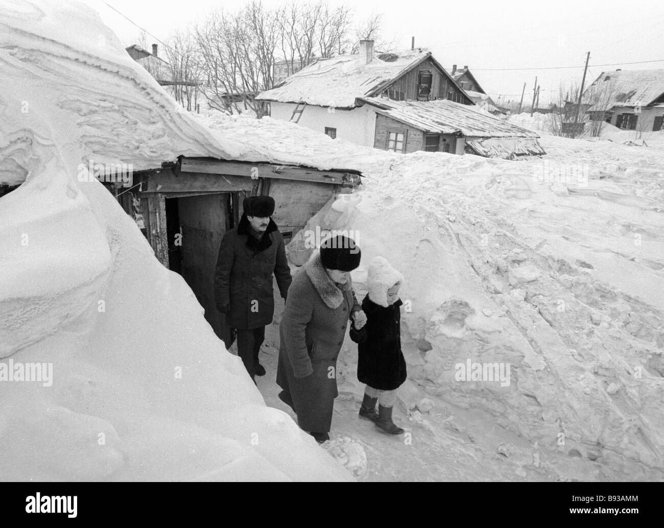 c19b4a00234d A miner family on the porch of their house smothered with snow stock image  jpg 1300x1034