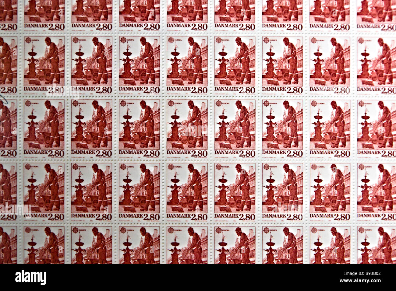 Old Danish stamp sheet with a road sweeper subject - Stock Image