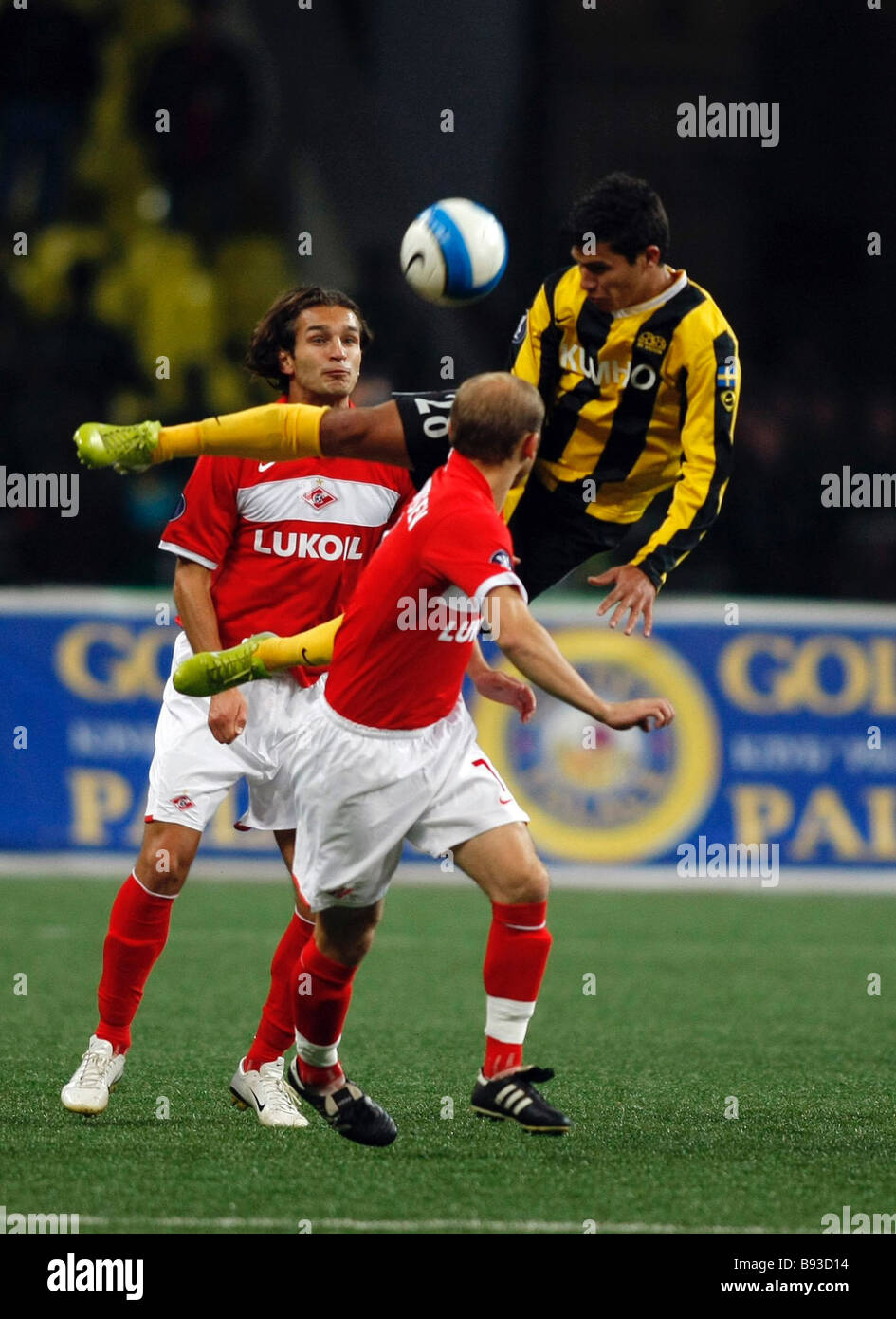 Paolo Jose Olivera leaping of Haecken Sweden football club and Denis Boyarintsev foreground and Renat Sabitov background - Stock Image