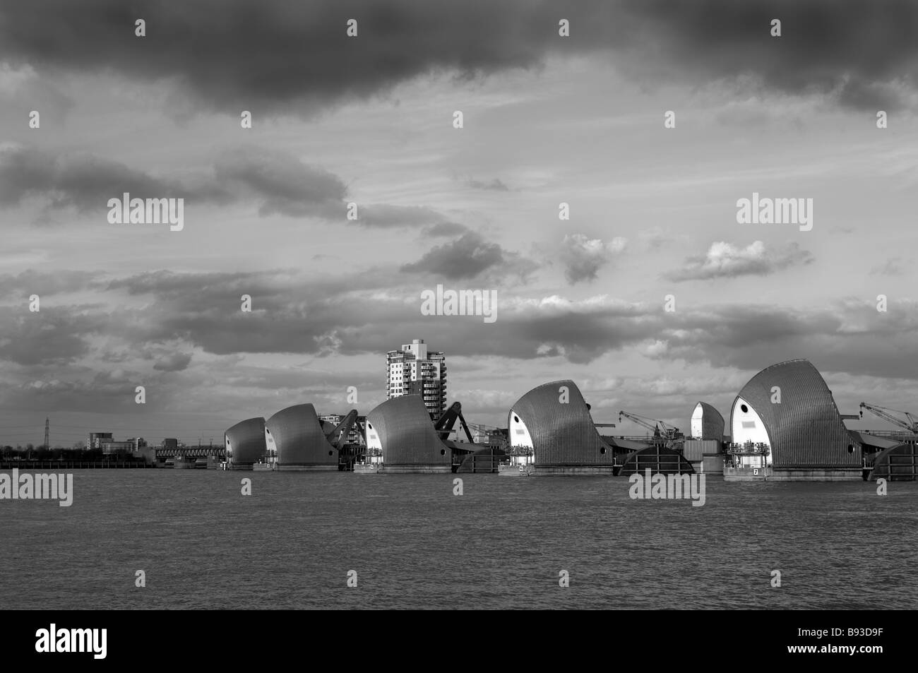 Thames Barrier on the river Thames, black and white image. - Stock Image
