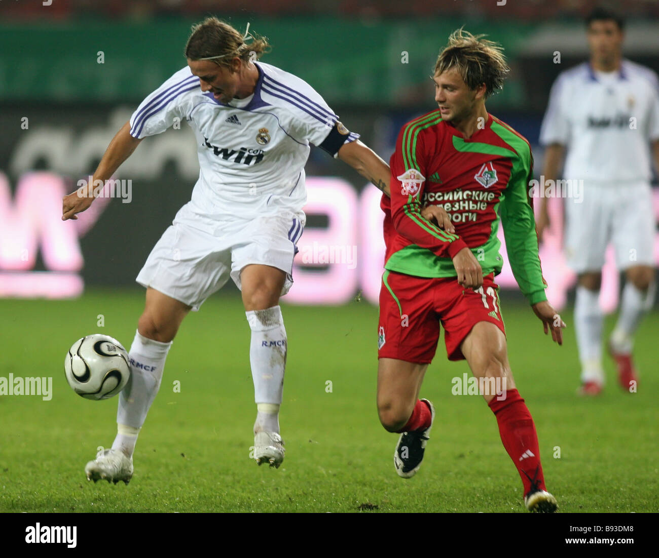 Real Madrid vice captain Jose Maria Gutierrez Hernandez left and Dmitry Sychyov Lokomotiv forward during a match - Stock Image