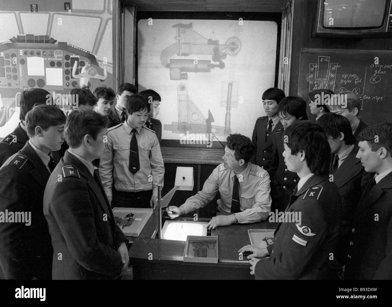 Students of the Yegorievsk Civil Aviation Technicians College listening to the instructor at airframe classes - Stock Image