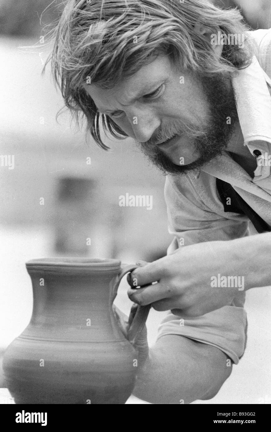 Edgar Ta participant in potters contest makes pitcher during All Handicrafts festival - Stock Image