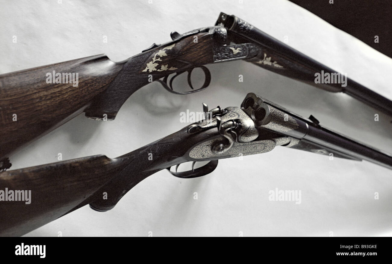 Gold engraved hunting carbine 1895 and triggerless double barrel hunting rifle covered with gold chasing 848 made Stock Photo