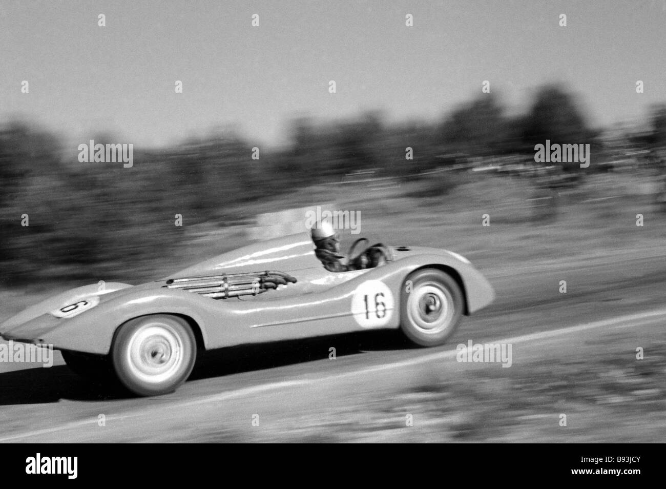 Yevgeny Veretov driving MZMA 1500 at 1959 national car racing championship on Minsk highway - Stock Image