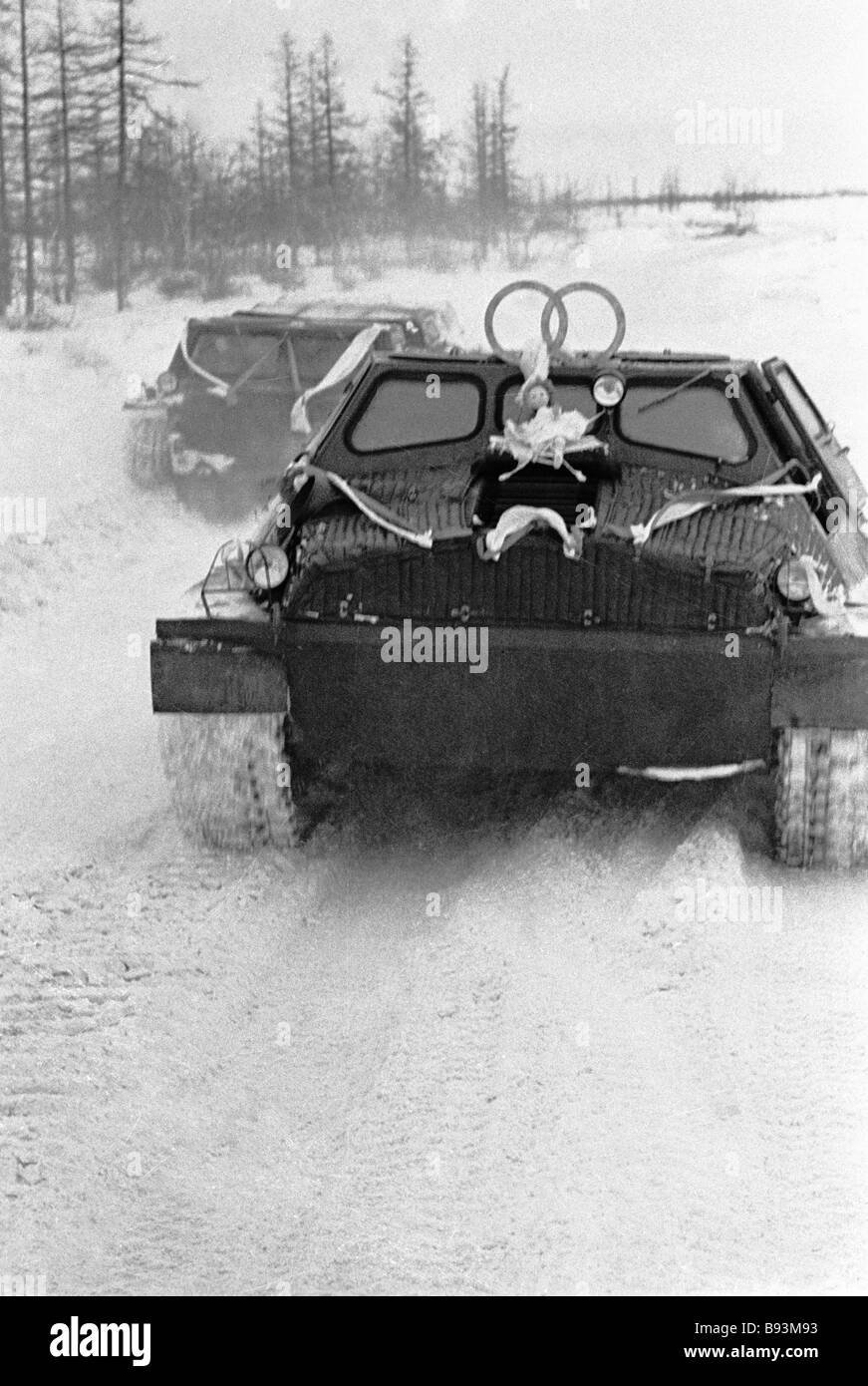 A cross country vehicle with an attached doll a wedding procession Arctic style - Stock Image