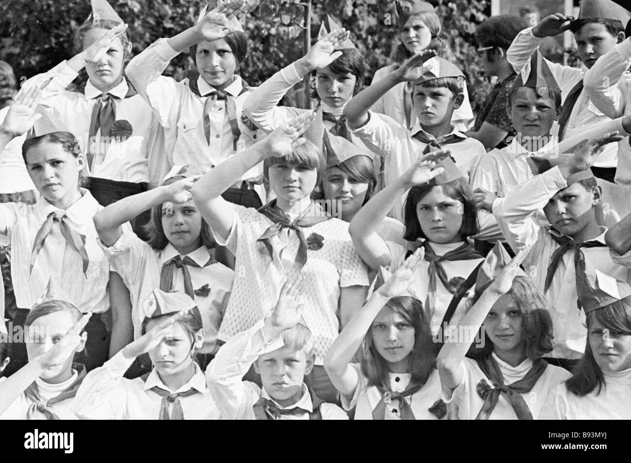 Pioneers saluting at a parade in honor of Pioneer Day - Stock Image