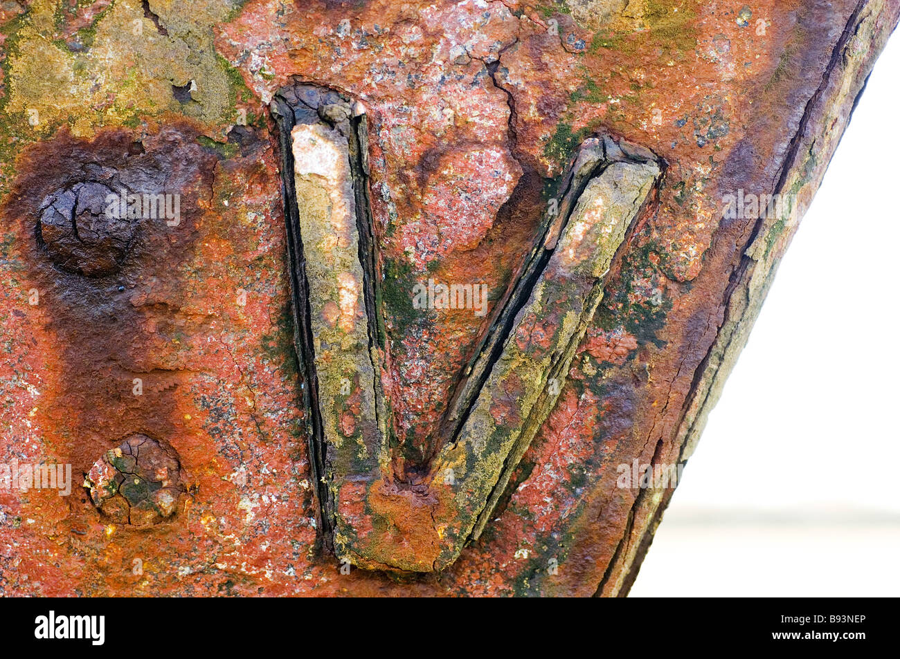 Rusting roman numerals on bow of abandoned fishing boats,Fleetwood,Lancashie,UK - Stock Image