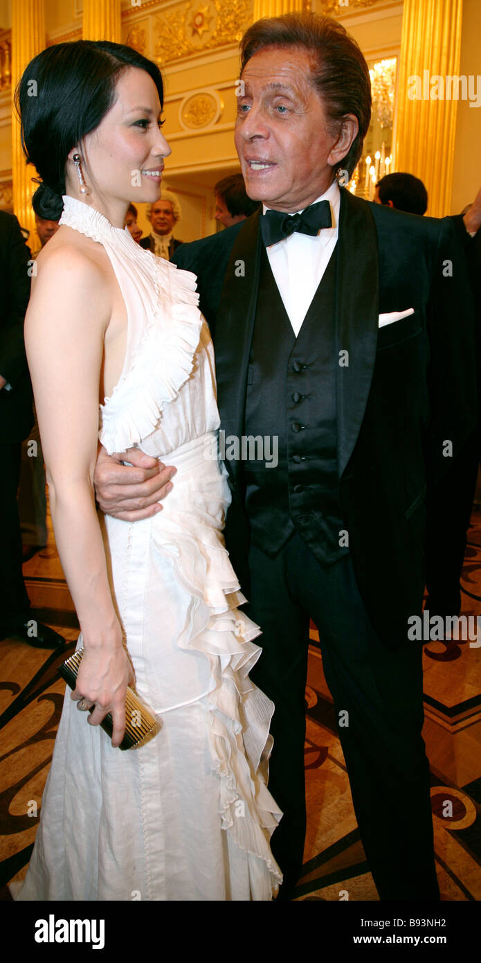 A Chinese American Hollywood actress Lucy Liu and glamorous fashion designer Garavani Valentino at The Love Ball - Stock Image