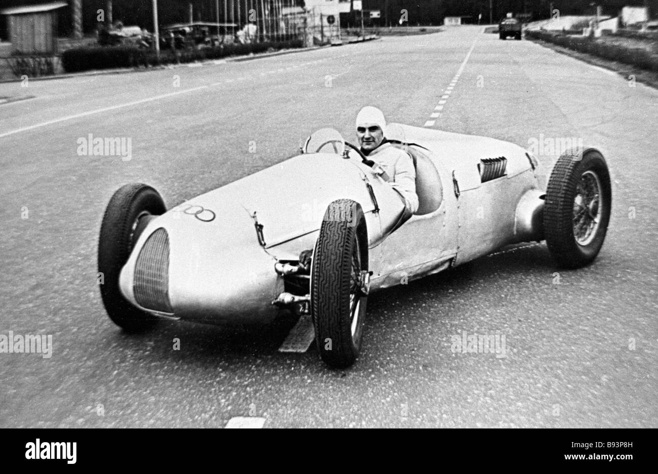 Chairman of antique cars club at the wheel of 1936 Auto Union racing car - Stock Image