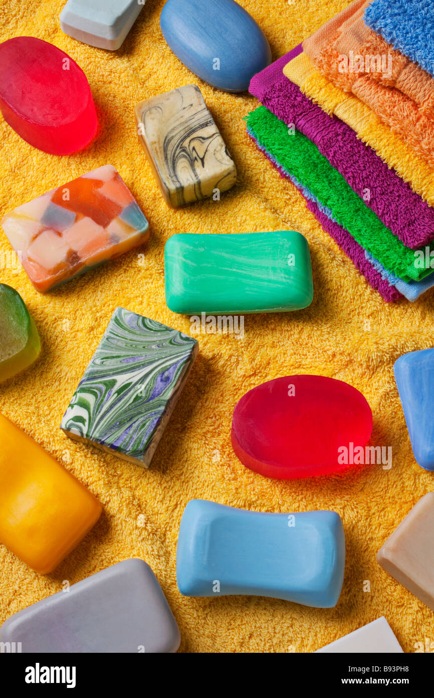 Assorted bars of soap on towel - Stock Image