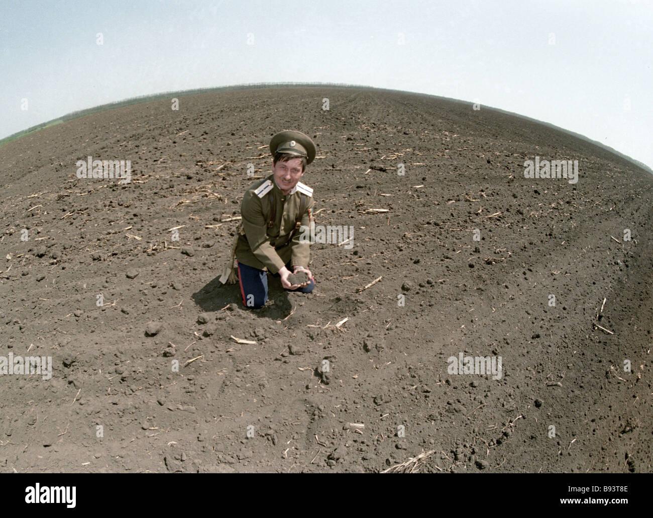 Sergei Listopadov a chieftain of Rassvet Sunrise village in the field - Stock Image