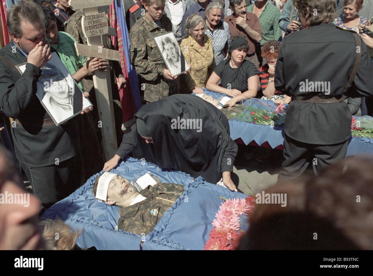 North Ossetian residents bury Terek Cossacks - Stock Image