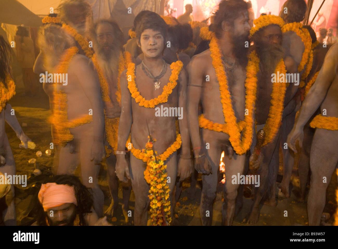 Naga Sadhus preparing for bathing in The holy river Ganges at Kumbh Mela Festival Allahabad, India - Stock Image