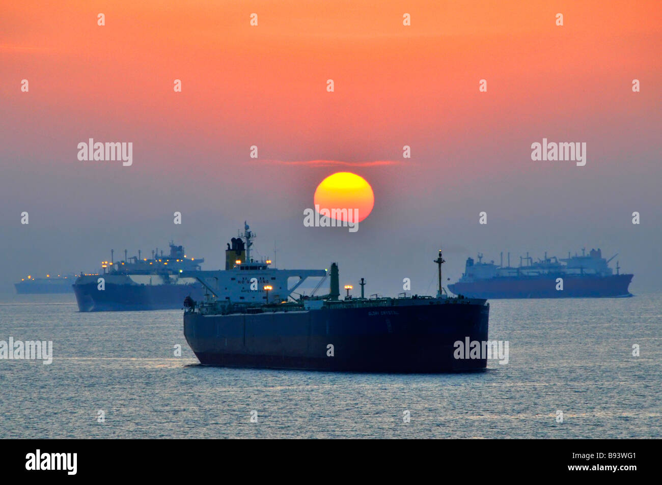 Shipping including bulk carriers & oil tankers at anchor off coast of Fujairah in Gulf of Oman near Straits - Stock Image
