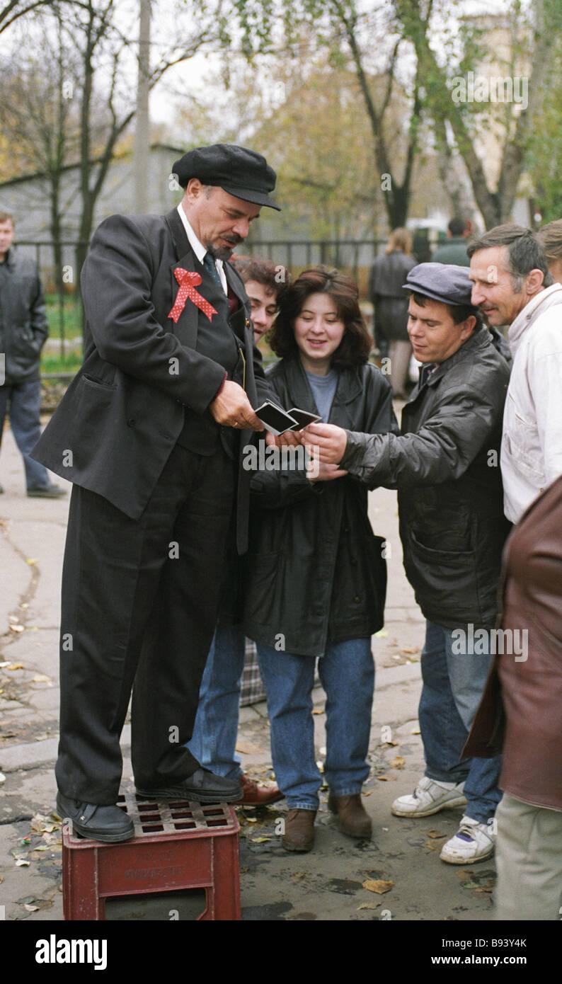Vladimir Lenin look alike offering his photographs - Stock Image