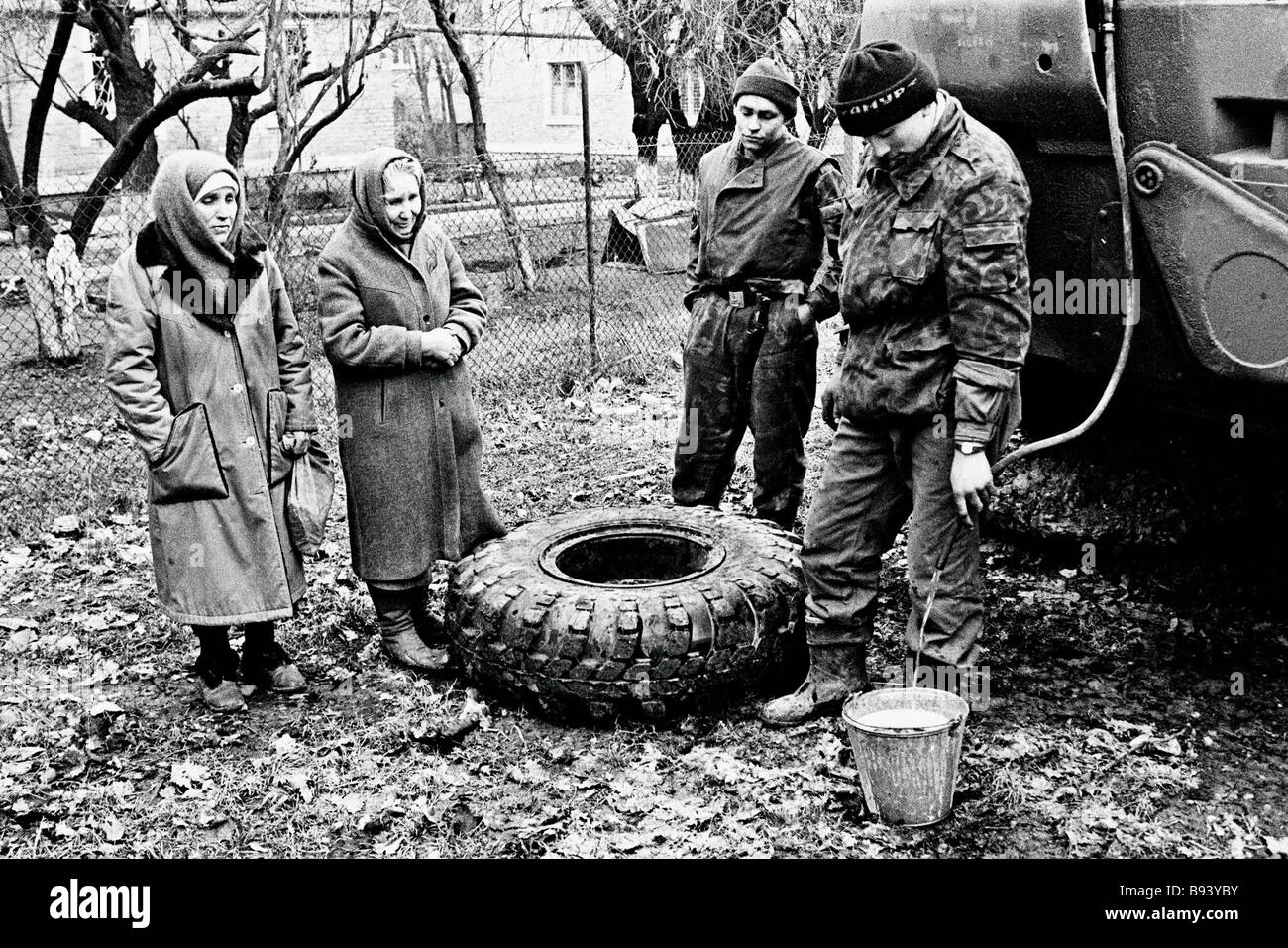 Soldiers of a marine logistics unit ration off drinking water for civilians in Grozny Chechen capital February 1995 - Stock Image