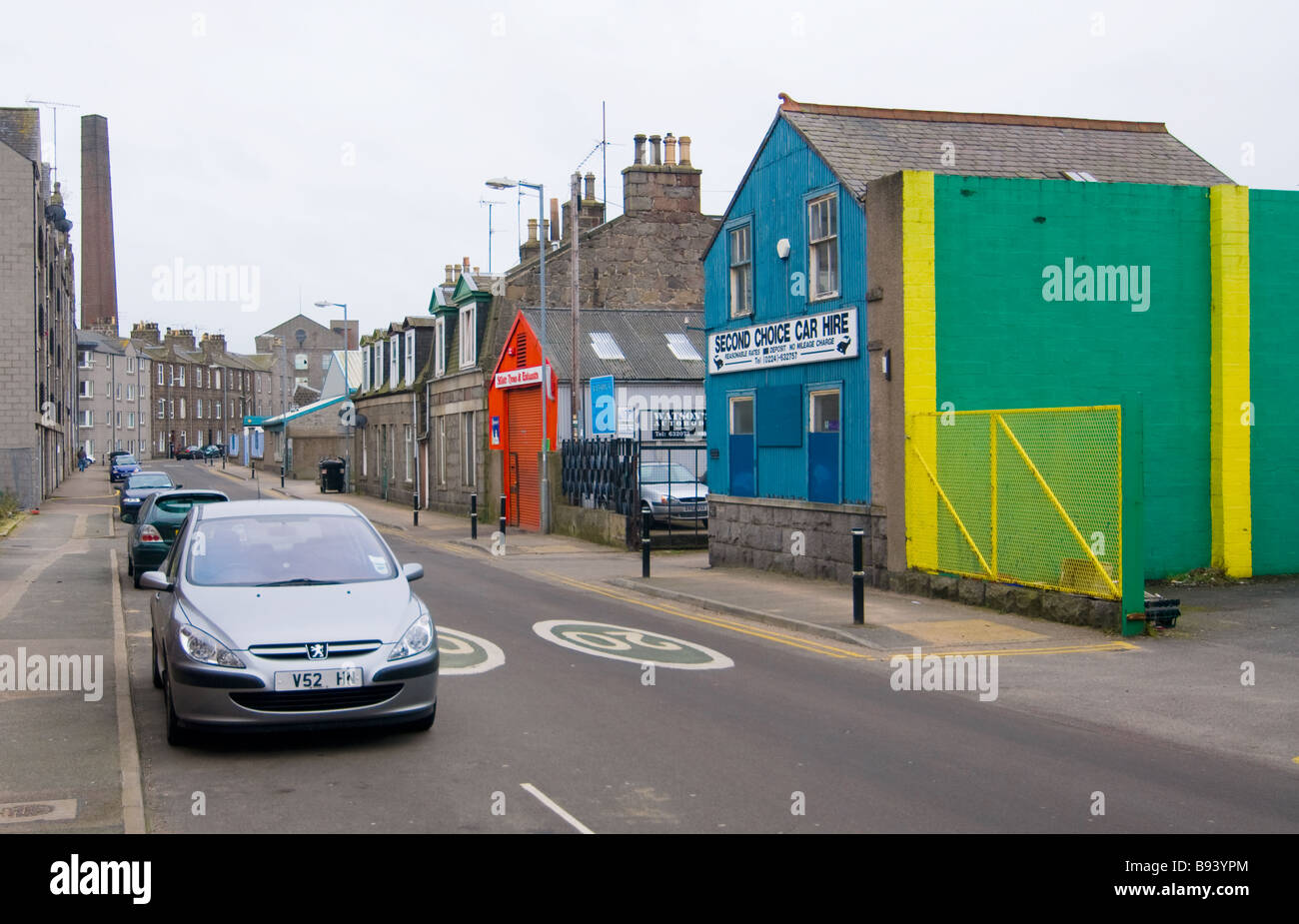 photograph of colourful shop fronts in granite street - Stock Image