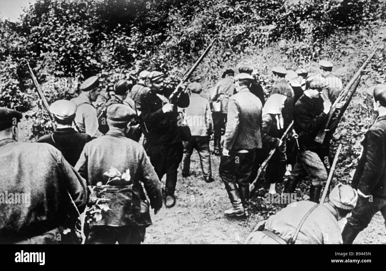 Partisans receiving weapons at a partisans base - Stock Image