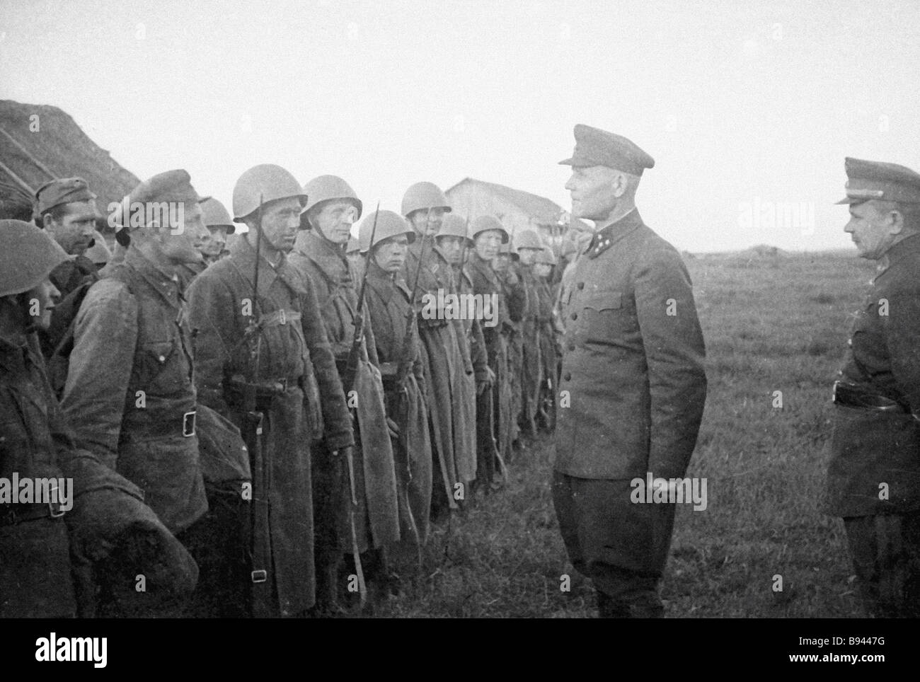 Colonel General Ivan Konev second right the Kalinin Front Commander talking to the soldiers of 31st Army - Stock Image