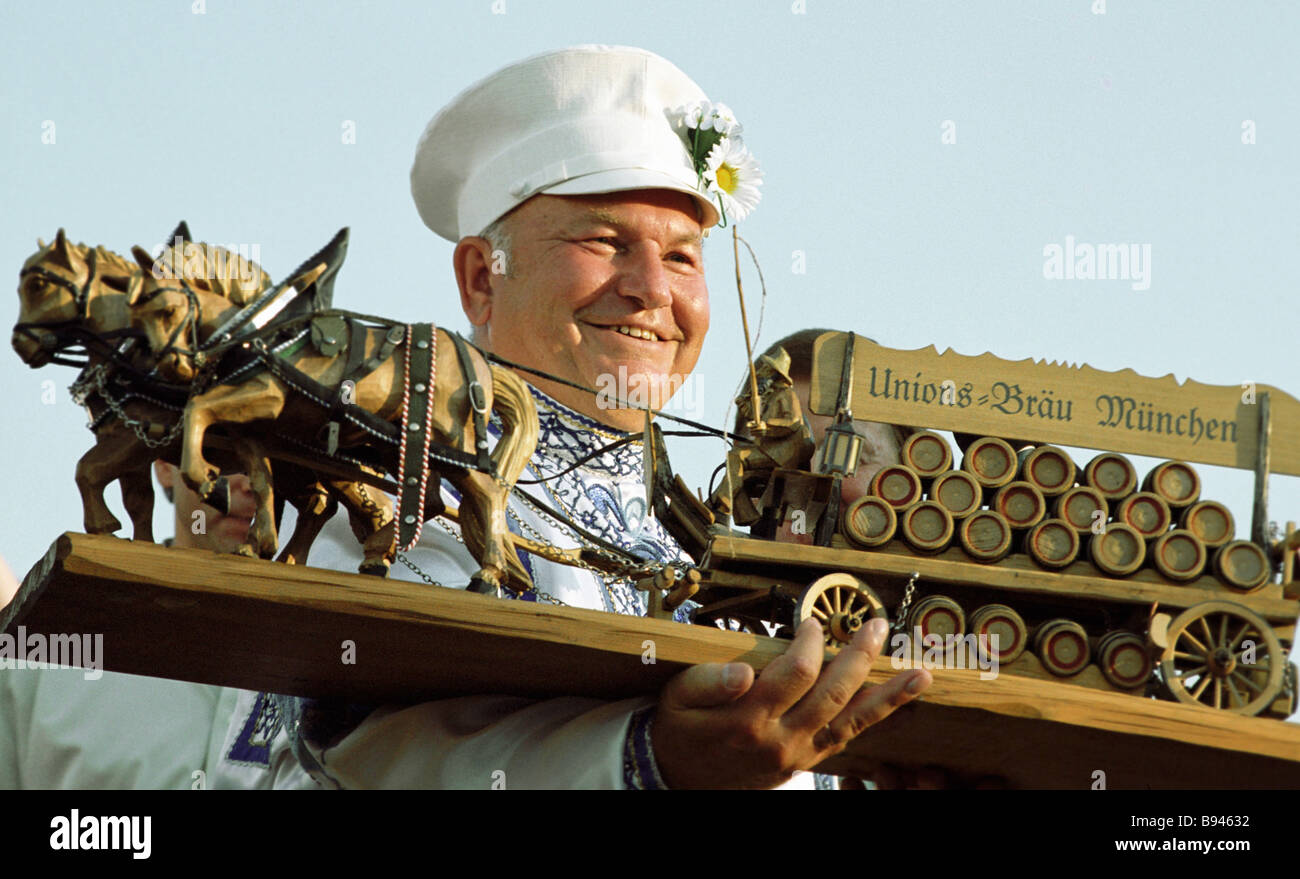 Moscow mayor Yury Luzhkov with a memento he got at the 3rd Moscow Beer Festival Bratina 2001 in Luzhniki - Stock Image