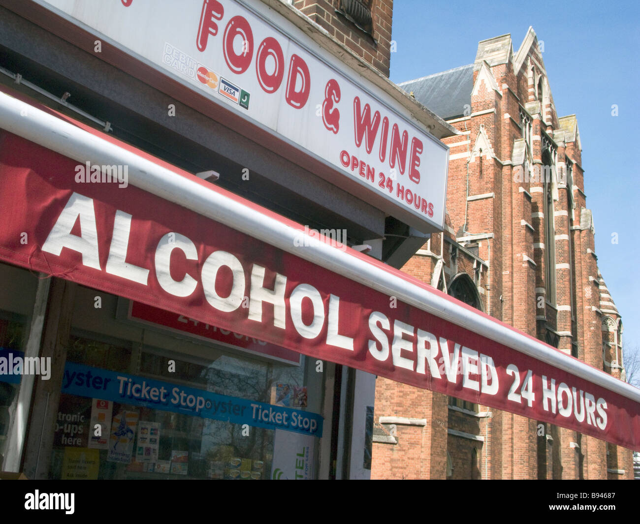 Sign advertising cheap alcohol available 24 hours a day at off license shop in Brixton,London,UK.Photo © Julio - Stock Image