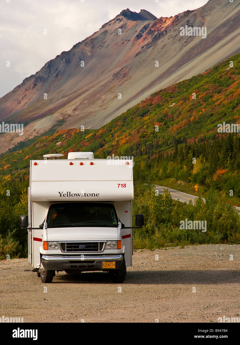 A motorhome on the Alaska Highway in fall. - Stock Image