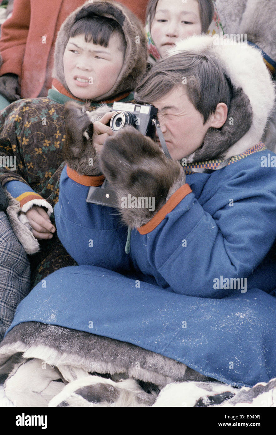 Spectators at a reindeer breeders festival - Stock Image
