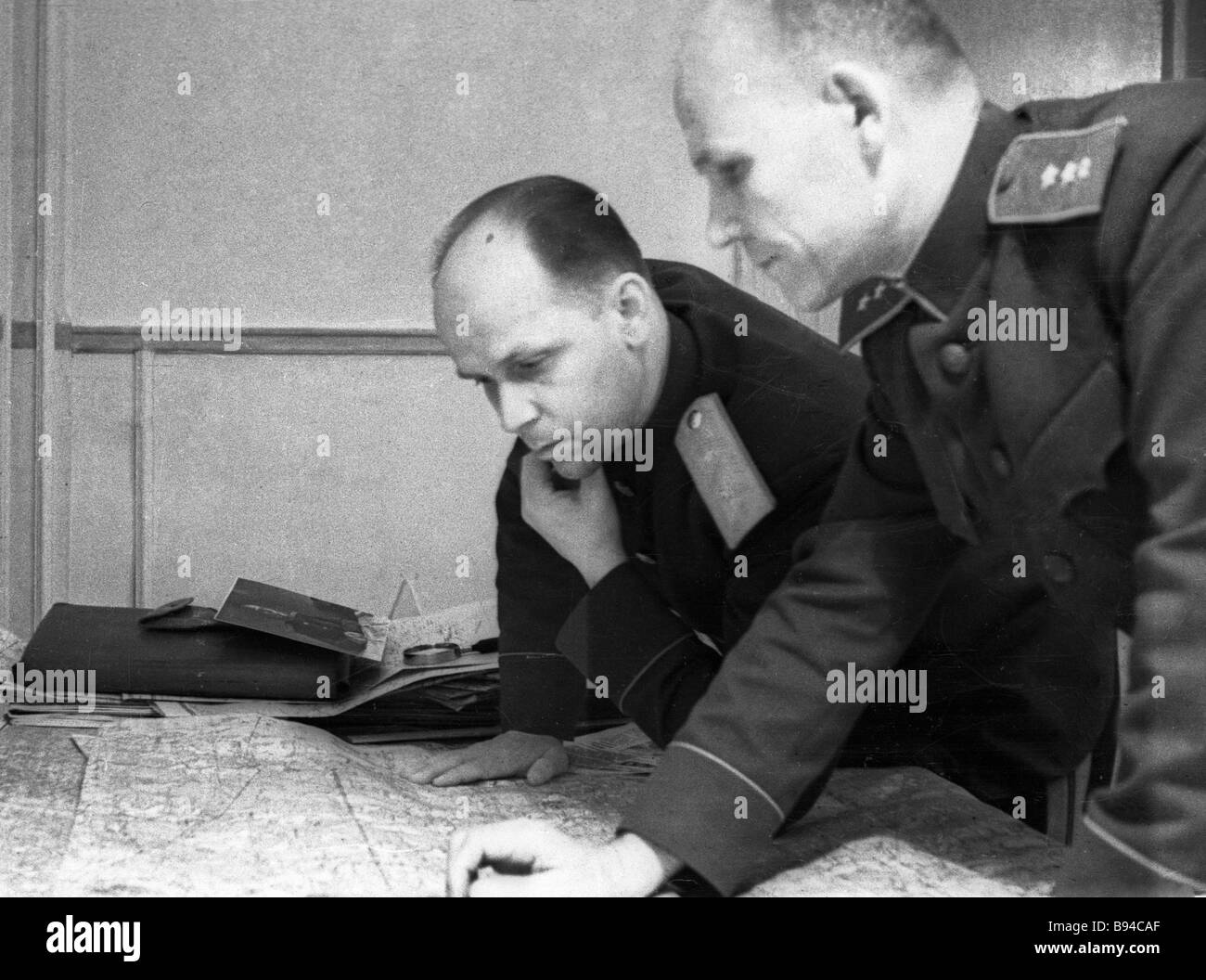 Ivan Konev the commander of the North West front right and Fyodor Bokov a member of military council left examine - Stock Image