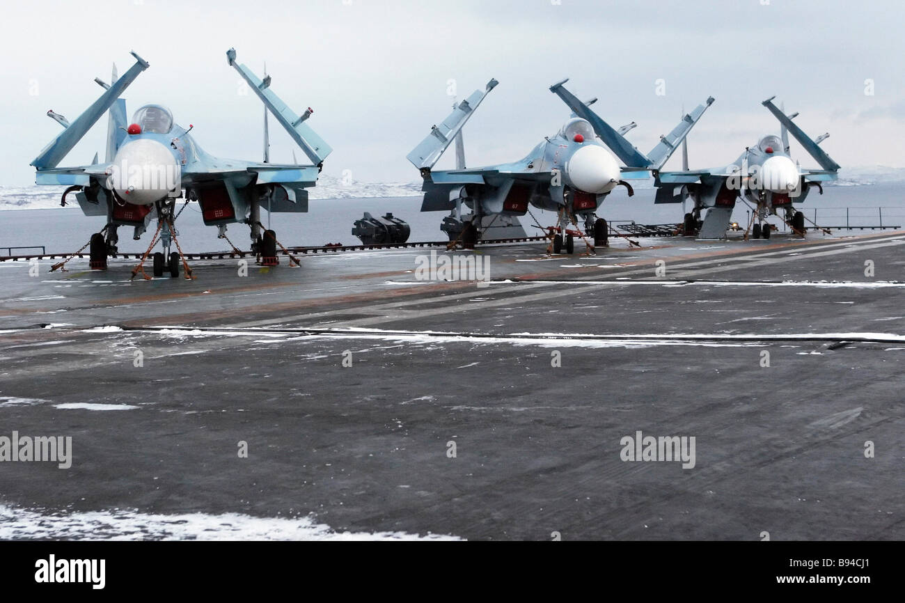SU 33 multi role carrier based fighters on board the Admiral Kuznetsov aircraft carrier - Stock Image