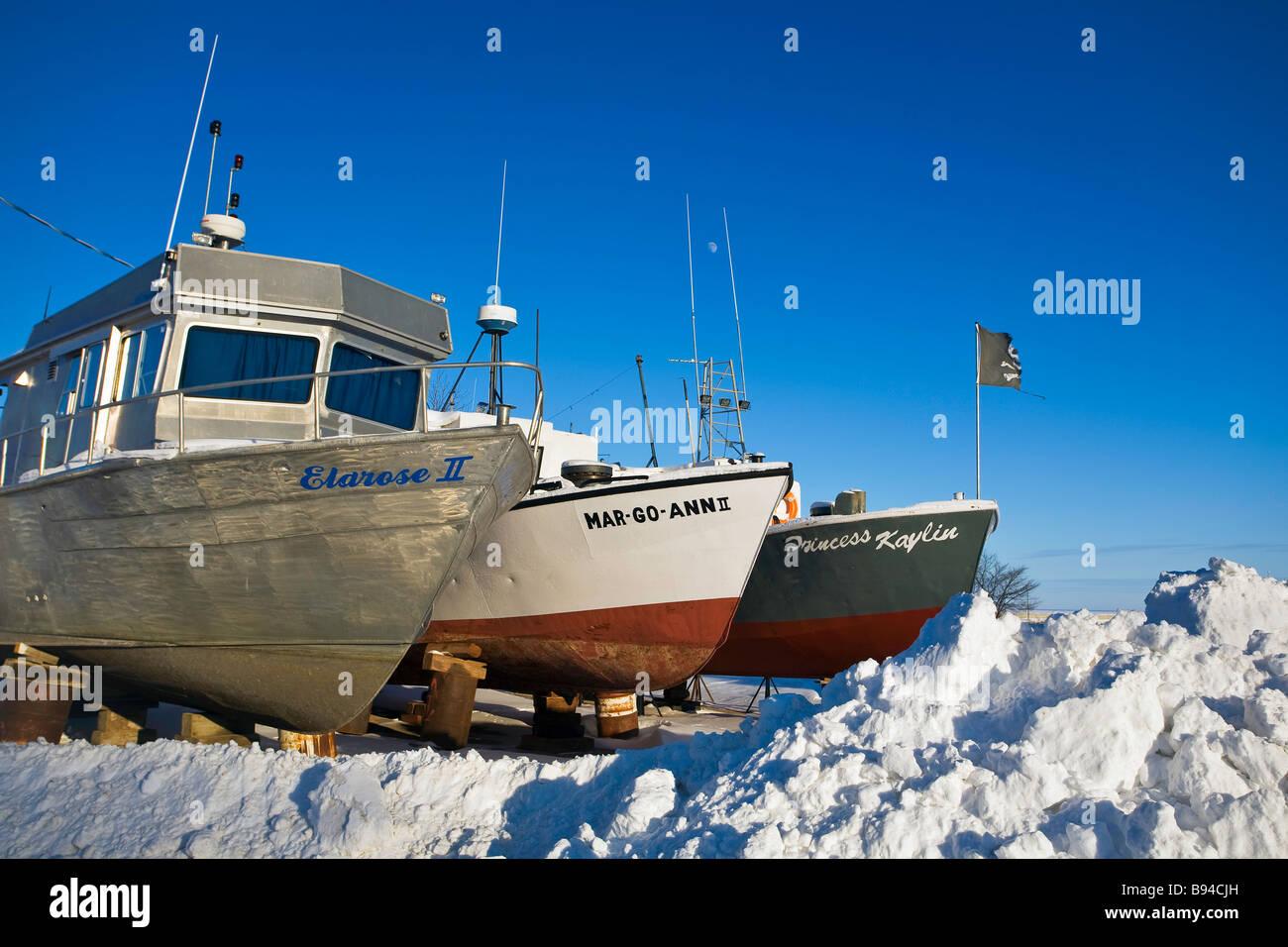 Fishing boats in winter dry dock, Gimli, Manitoba, Canada - Stock Image