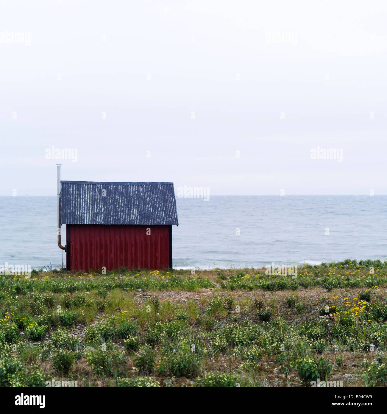 Red barn at the sea - Stock Image