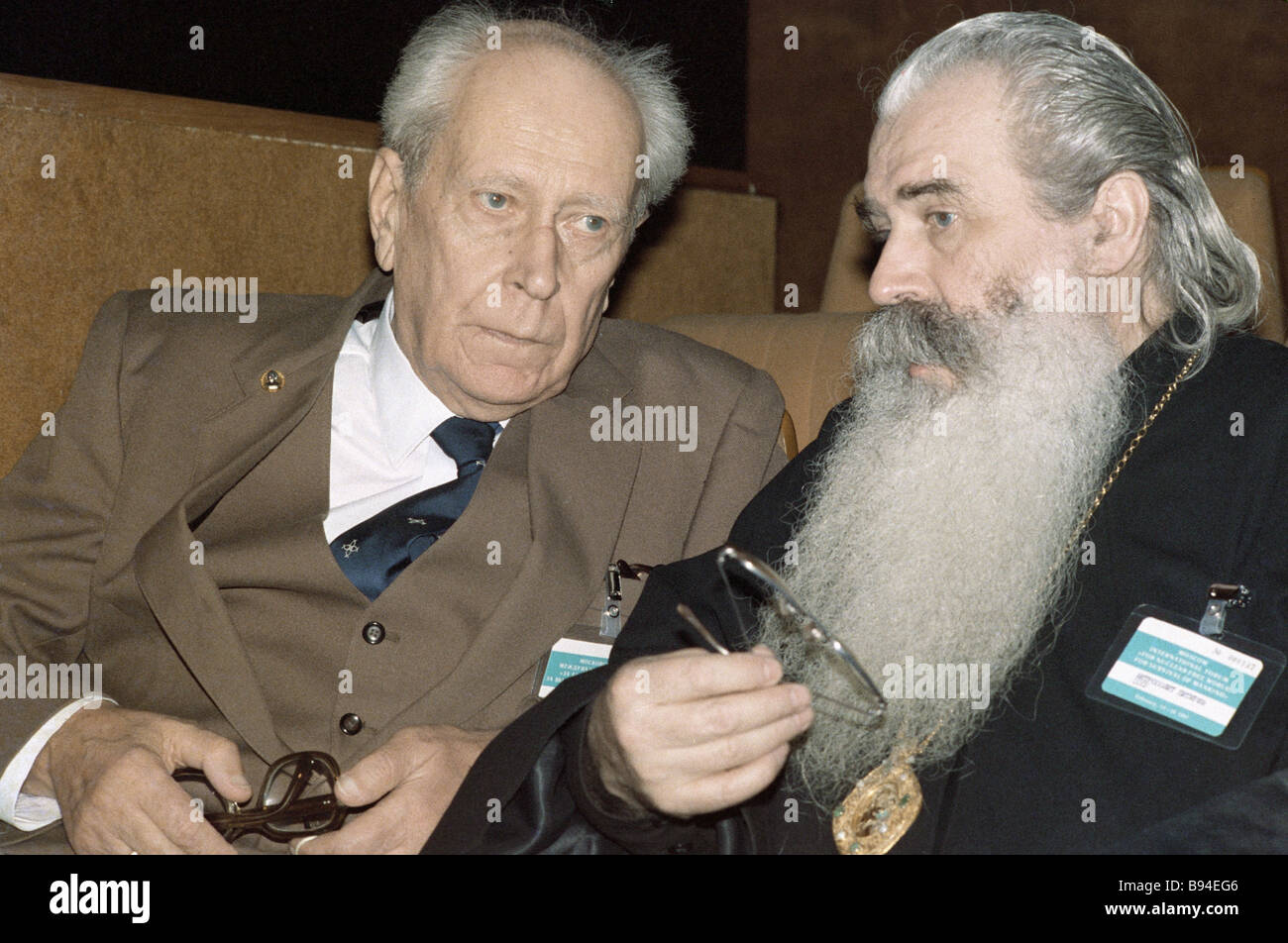 Philologist Dmitry Likhachev left and Metropolitan Pitirim right attend forum For a Nuclear Free World and for the - Stock Image