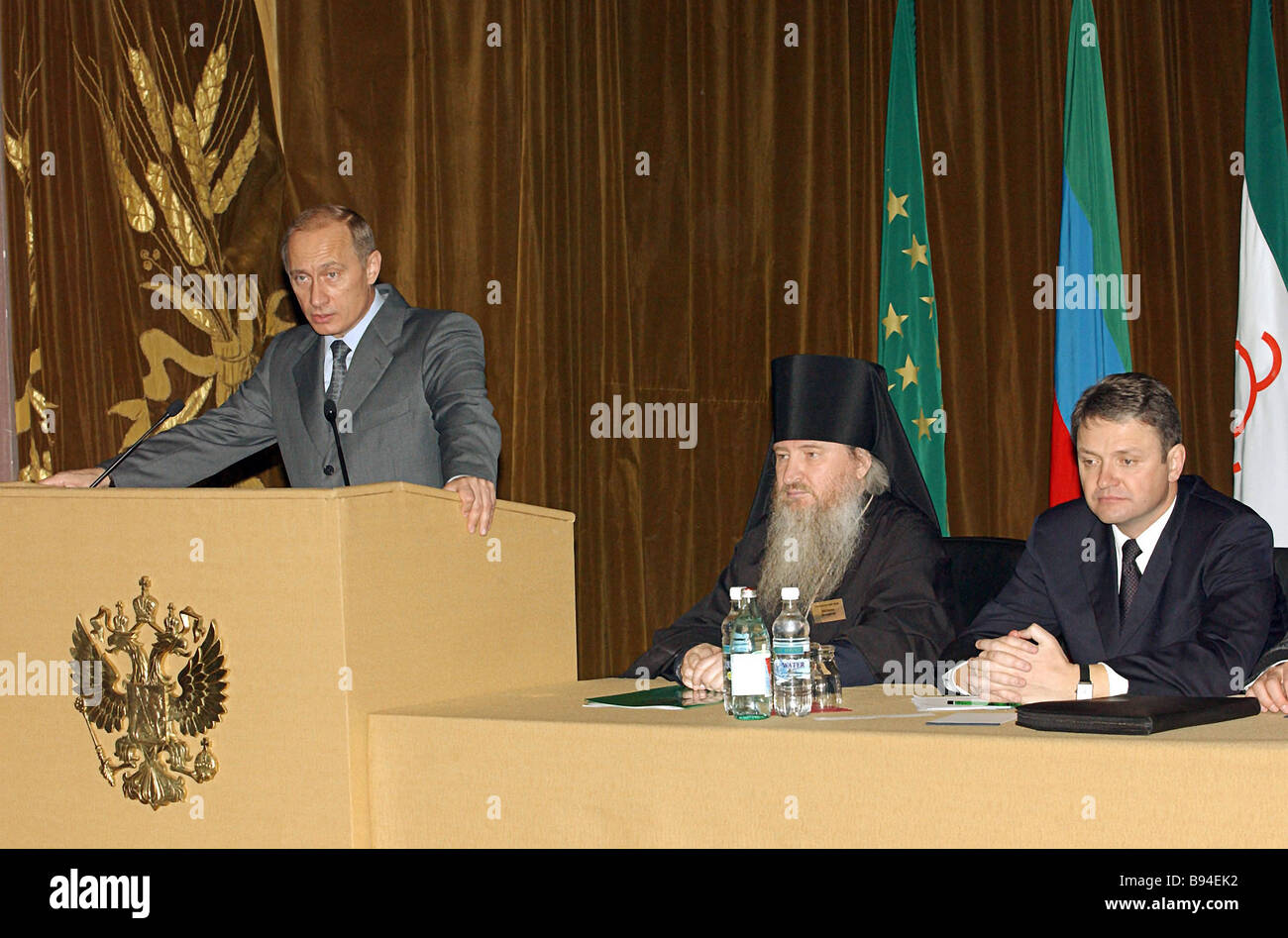 Russian President Vladimir Putin on the rostrum Theophanes the Bishop of Stavropol and Vladikavkaz in the center - Stock Image