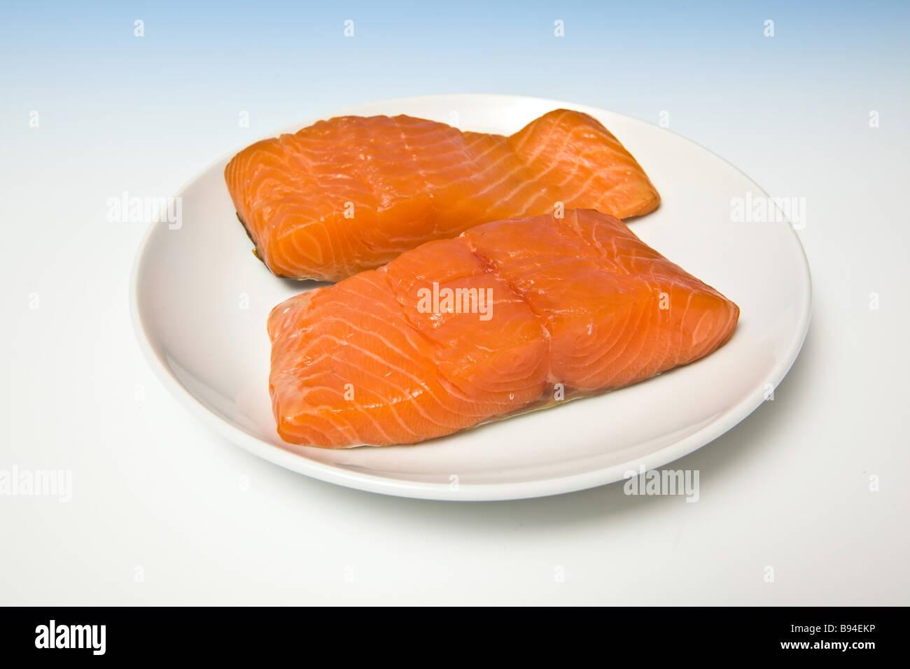 Smoked salmon pieces - Stock Image