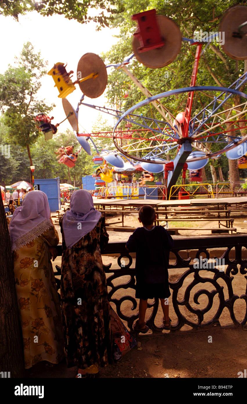 Amusements in Dushanbe city park - Stock Image