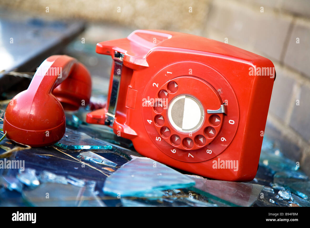 Old UK red phone abandoned in a derelict old building - Stock Image