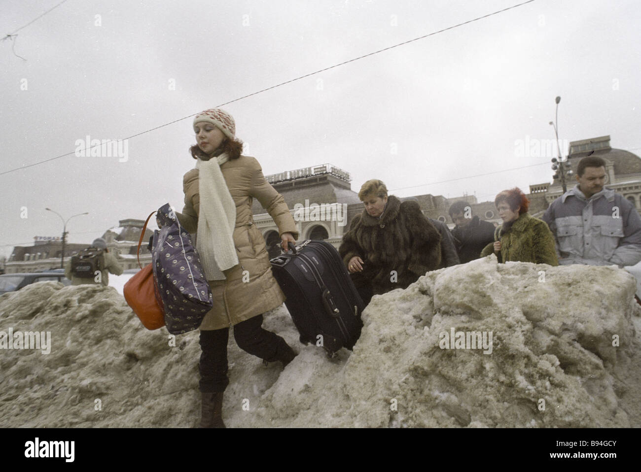 Muscovites and guests of the city struggle through the snowdrifts - Stock Image