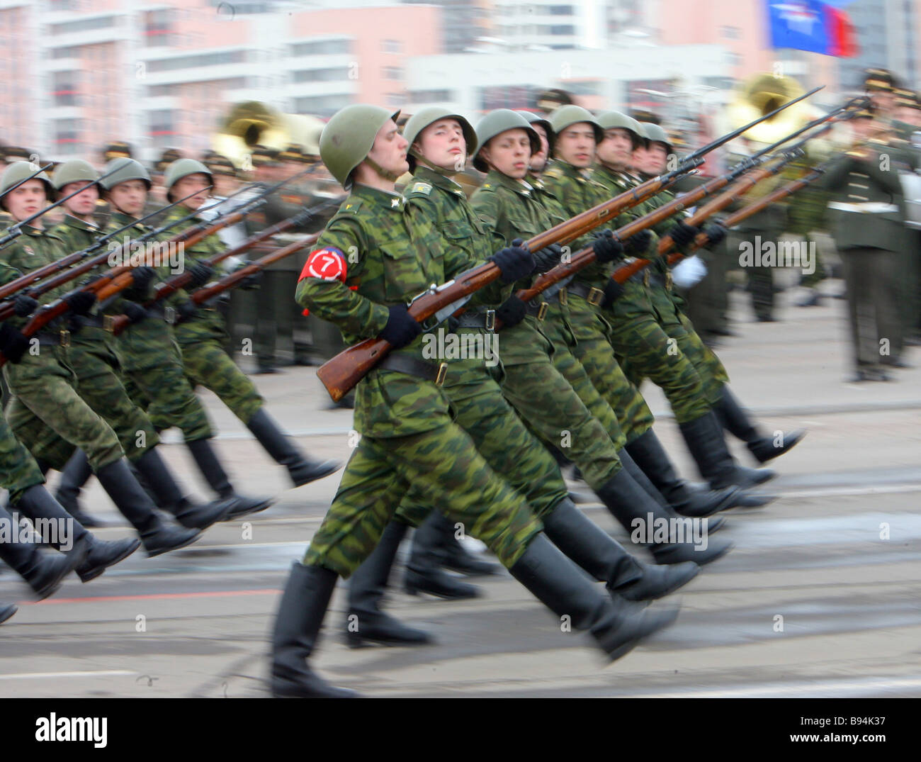 Army servicemen marching during a rehearsal of the Victory Day parade at Moscow s Frunze airfield - Stock Image