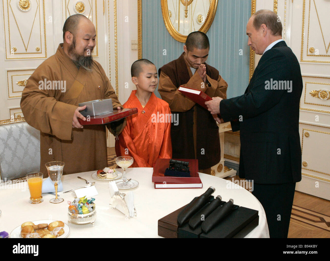 Russian President Vladimir Putin right meeting with monks of China s Shaolin temple - Stock Image