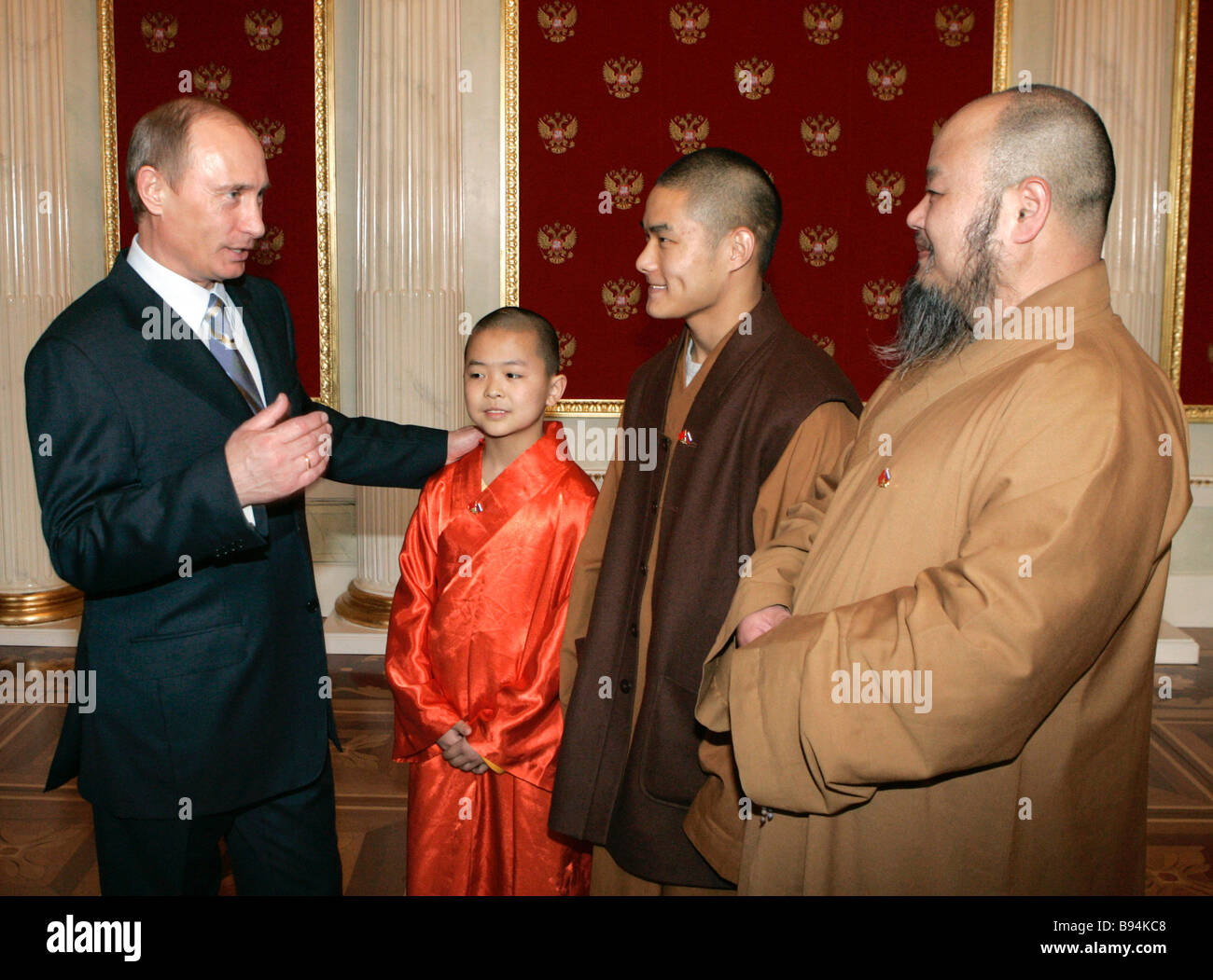 Russian President Vladimir Putin left meeting with monks of China s Shaolin temple - Stock Image