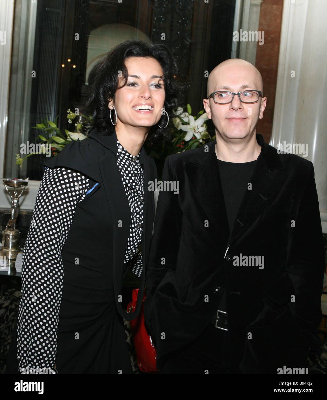 TV presenter Tina Kandelaky and Azamat Tseboyev the editor in chief of the Menyu udovolstviy magazine during a reception - Stock Image
