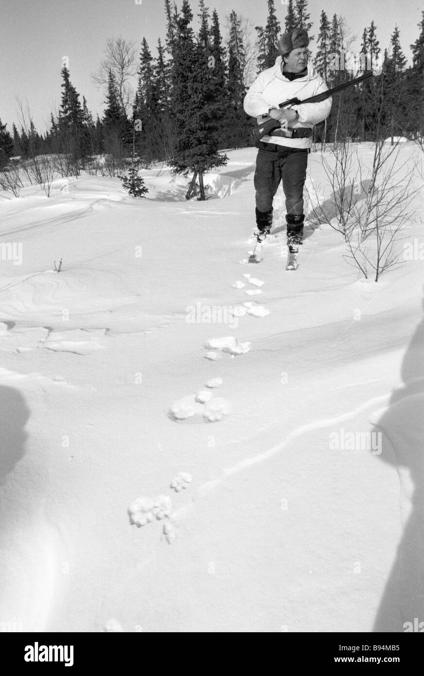A hunter following the hare tracks - Stock Image