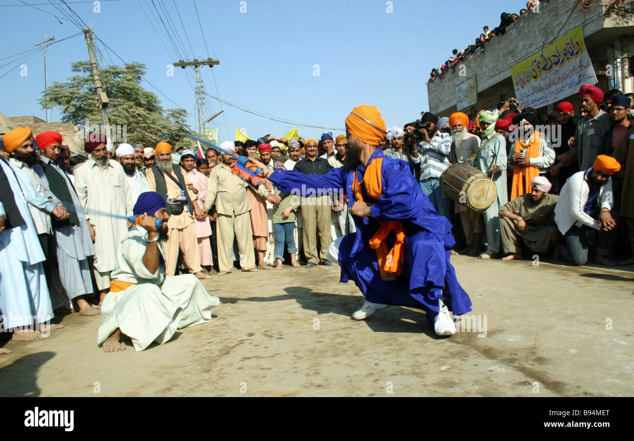 Sword fighting is regular at Sikh holidays Sikhs are the best sword fighters in South Asia Pakistan - Stock Image