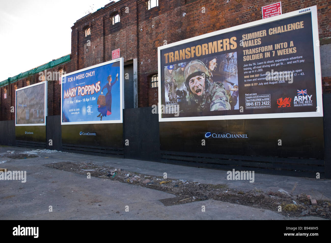 Advertising billboards on derelict building in Newport South Wales UK - Stock Image