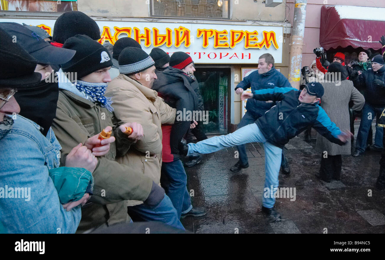 Russky Marsh Russian March participants clash with anti fascists in St Petersburg - Stock Image