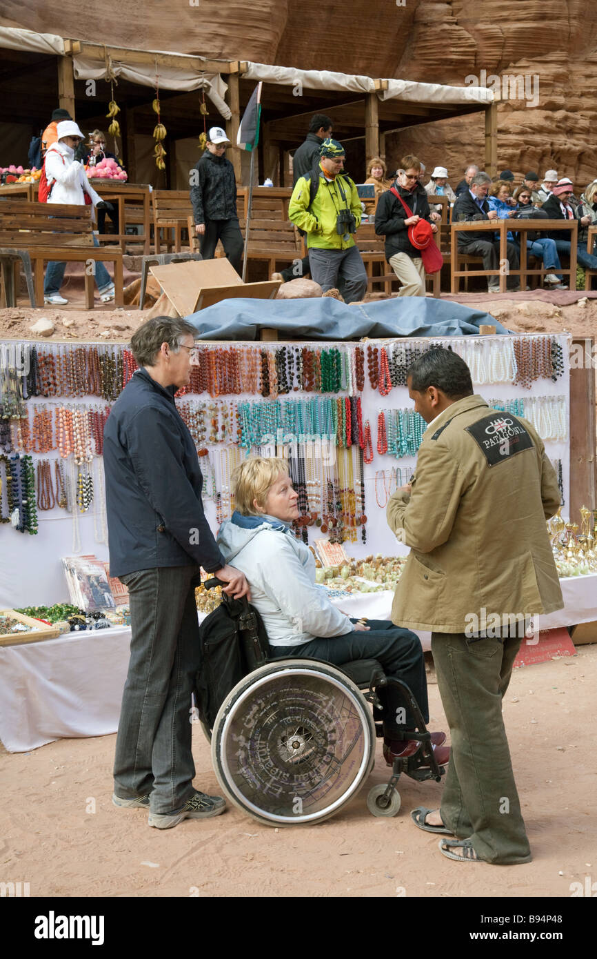 A disabled lady in a wheelchair buying souvenirs, Petra, Jordan - Stock Image