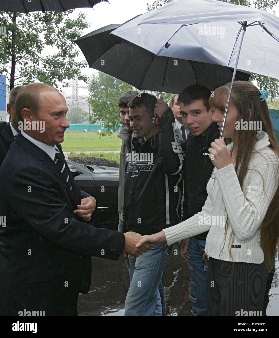 President Vladimir Putin left talks to students during the visit to the Khimki Space Power Machinery Construction - Stock Image